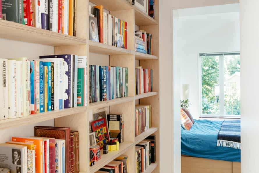 In the absence of an attic, storage is integrated as far as possible.  Here, the upstairs hallway leading to the master bedroom is lined with bookshelves