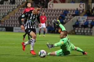 Miguel Almiron goes around Morecambe's goalkeeper Mark Halstead on his way to scoring Newcastle's second.