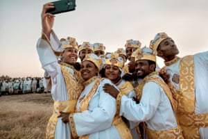 Addis Ababa , EthiopiaOrthodox christians take a selfie during the annual celebration of the Ethiopian Epiphany. Timkat is the Ethiopian Orthodox Christian festival which celebrates the baptism of Jesus in the Jordan river.