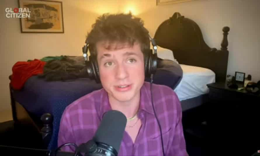 Musician Charlie Puth with his unmade bed in the background.