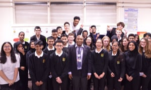 Francis Elive with his class of high achievers at Fitzalan High school in Cardiff.