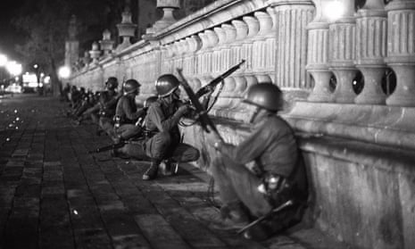 Soldiers crouch in the Tlatelolco district of Mexico City during the night of violence on 2 October 1968.