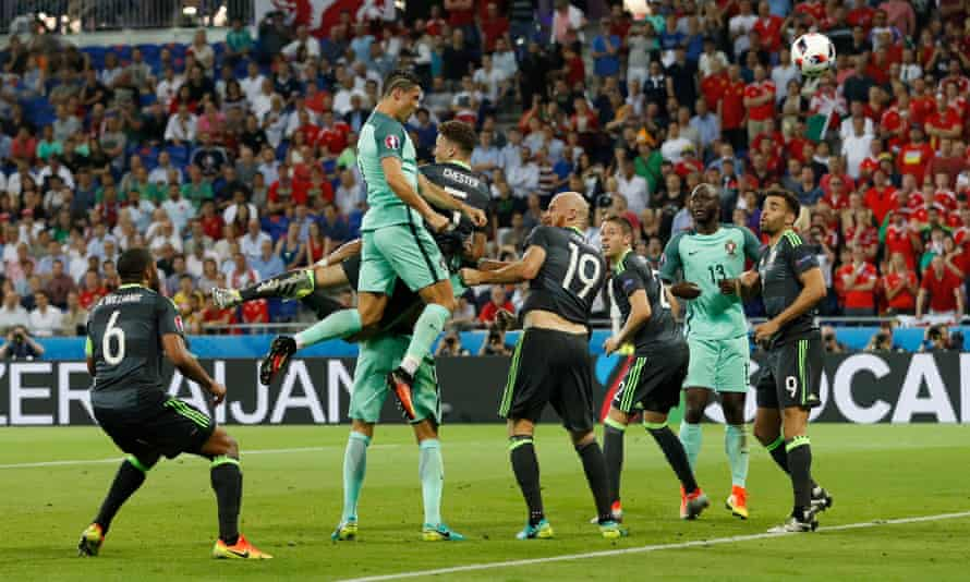 The Wales defence can only watch as Cristiano Ronaldo heads in the opening goal of the Euro 2016 semi-final for Portugal.