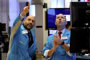 Specialists Meric Greenbaum, left, and Jay Woods work on the floor of the New York Stock Exchange today