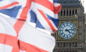 A British Union Jack flag and a flag of England fly in front of Big Ben.