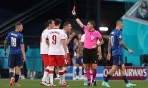 Grzegorz Krychowiak is shown a red card by match referee Ovidiu Hategan.