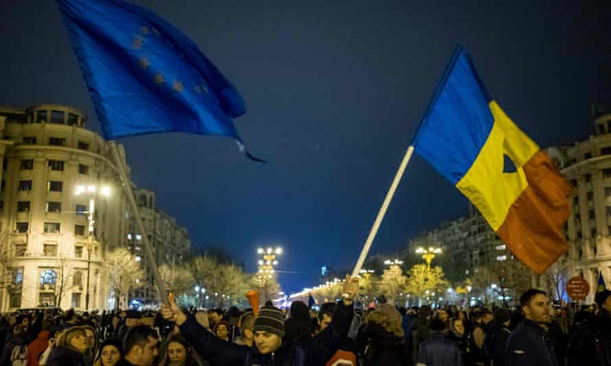 A man waves EU and Romanian flags during a protest against corruption in Bucharest, February 2017