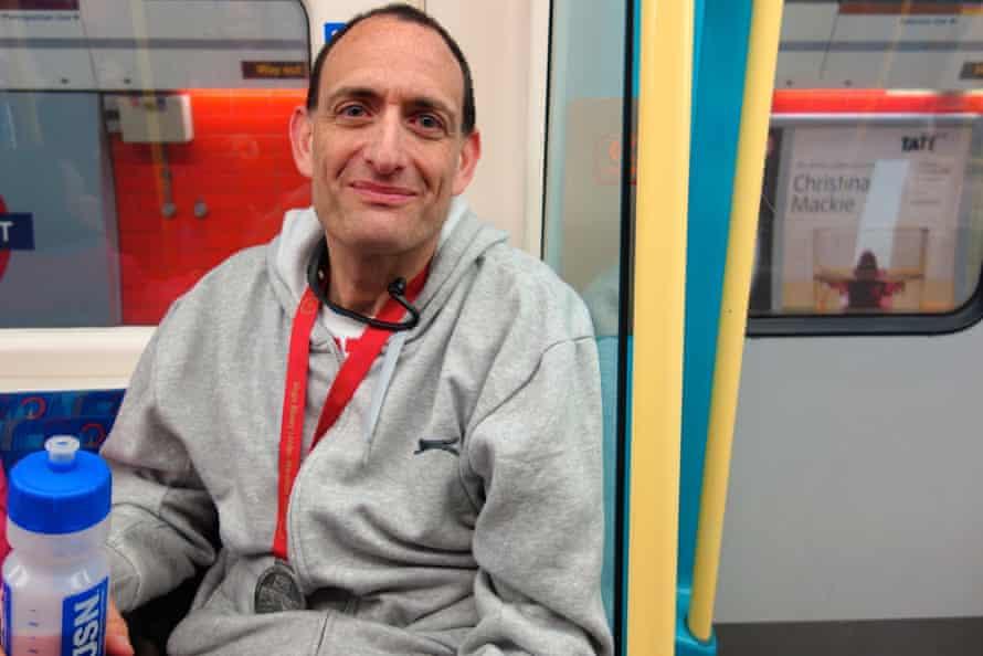 Man on tube, London.