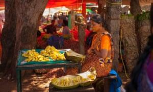 A woman sells jackfruit in a market in Karaikudi, Tamil Nadu.
