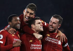 James Milner celebrates scoring Liverpool's second goal against Leicester City with Georginio Wijnaldum, Roberto Firmino and Jordan Henderson at the King Power on 26 December 2019.