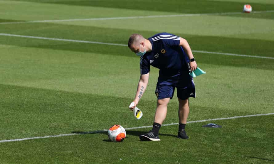 A Premier League ball is sprayed with disinfectant at Wolves' training complex.