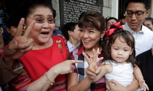 Imee Marcos (centre in checked shirt) pictured in Manila last year with her mother, the former first lady Imelda Marcos.