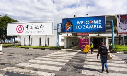 A Bank of China billboard and a Pepsi advertisement stand outside the arrivals area at Kenneth Kaunda International Airport in Lusaka, Zambia.