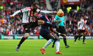 Steven Fletcher of Sunderland and Newcastle's  Moussa Sissoko clash in the last Stadium of Light derby in 2015