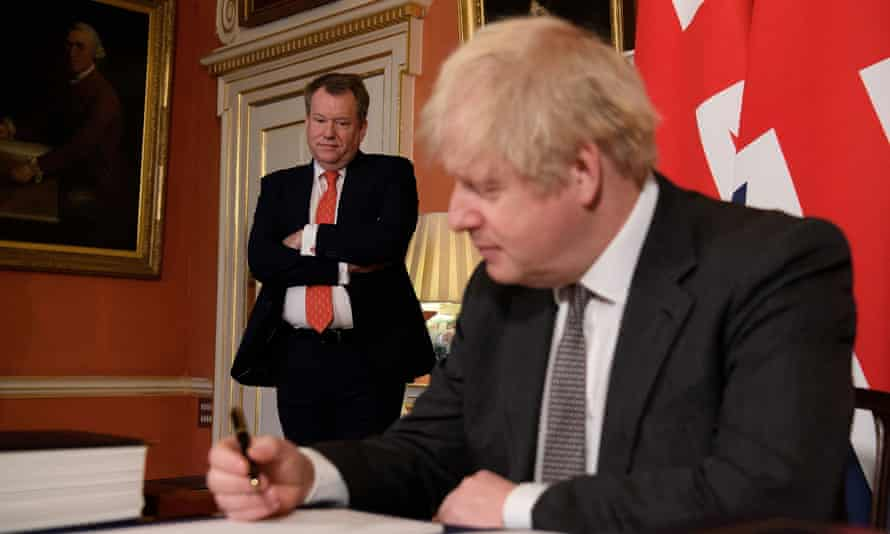 UK chief negotiator David Frost looks on as Boris Johnson poses for a picture after signing the Brexit trade deal with the EU on 30 December, 2020.