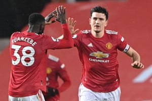 Harry Maguire is congratulated by Axel Tuanzebe.