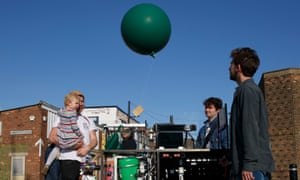 A helium balloon is released with a message attached as part of the Attachment poetic concept at the Waterfront