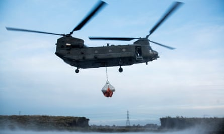A Royal Air Force Chinook helicopter helping repairs to a damaged river bank in Lancashire in 2015.