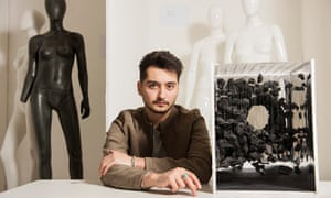 Ammar Alsaker, a Syrian refugee studying at the London College of Fashion, with one of his designs.