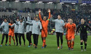 Dutch captain Virgil van Dijk leads the celebrations at the final whistle.