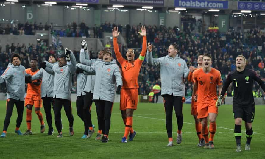 Dutch captain Virgil van Dijk leads the celebrations at the final whistle.
