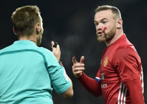 Rooney remonstrates with referee Mike Jones.