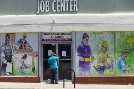 A man looks inside the closed doors of the Pasadena Community Job Center.
