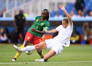 Ajara Nchout of Cameroon beats Ria Percival of New Zealand to score her team's second goal.
