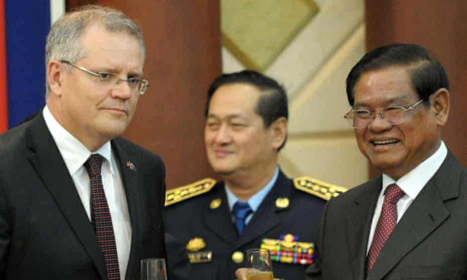 Scott Morrison, the then immigration minister, and Cambodia's interior minister, Sar Kheng, sharing a toast in Phnom Penh