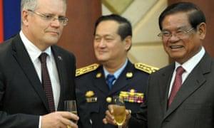 Scott Morrison toasts the deal in Phnom Penh last September.