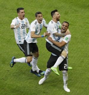 Argentina's Gabriel Mercado, right, celebrates with Messi.