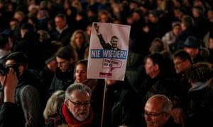A placard showing the AfD regional leader Björn Höcke reads 'Never again' during a vigil in Hanau on Thursday.