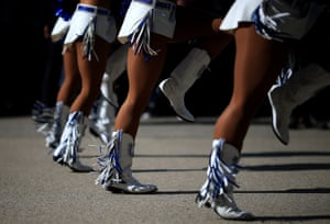 Indianapolis Colts cheerleaders perform outside the stadium ahead of the NFL International Series match between Indianapolis Colts and Jacksonville Jaguars at Wembley stadium
