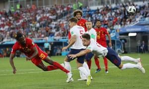 Dedryck Boyata of Belgium heads at goal.