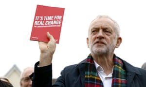 Labour party leader Jeremy Corbyn holds up his party's manifesto as he speaks to supporters during a visit to Thurrock in Essex