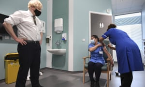 Boris Johnson watches as a nurse gets a vaccination in a London hospital. The RCN has condemned the 1% pay rise for NHS staff.