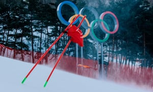 A gate flag flutters in the wind after the women's giant slalom was postponed due to high winds.