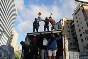 Protesters vandalize a lorry as thousands take to the streets