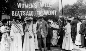 Suffragettes in 1908 hold a banner referring to Herbert Asquith