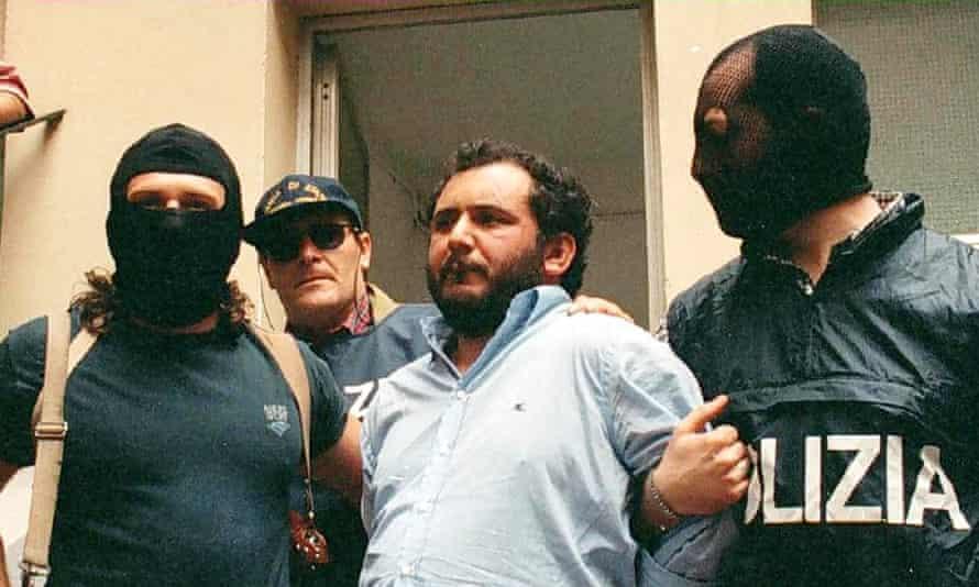Guards escort Giovanni Brusca