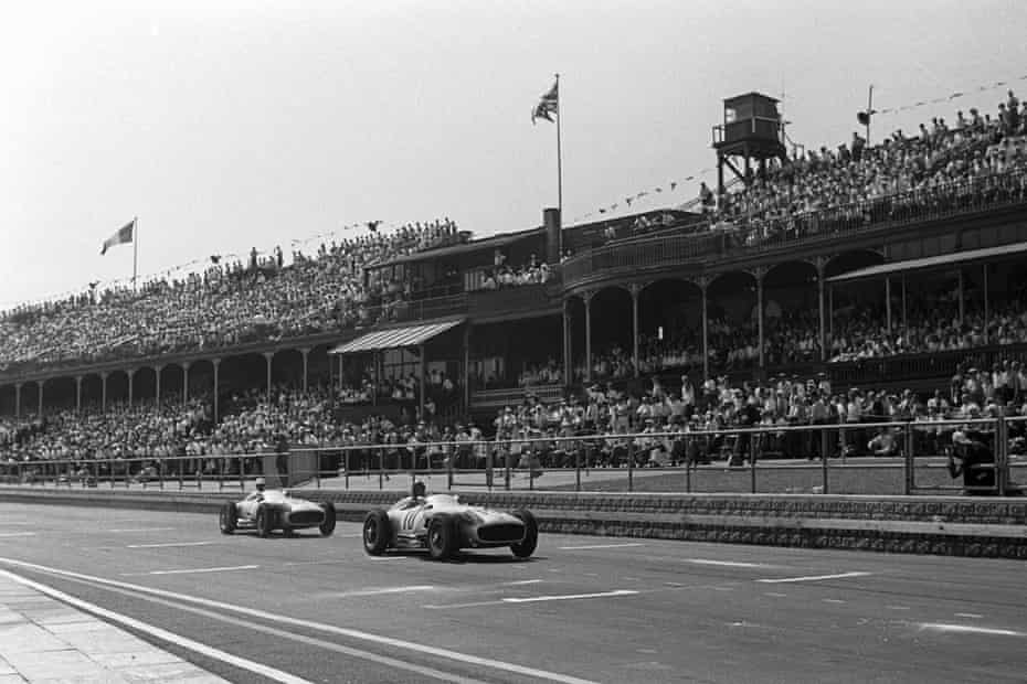 The 1955 British Grand Prix at Aintree with Mercedes drivers Moss and Fangio leading the field.
