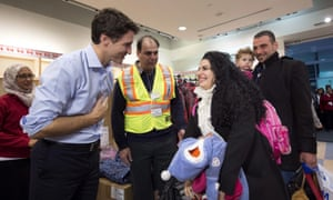 Justin Trudeau greets refugees fleeing from Syria, in Toronto on 11 December 2015.
