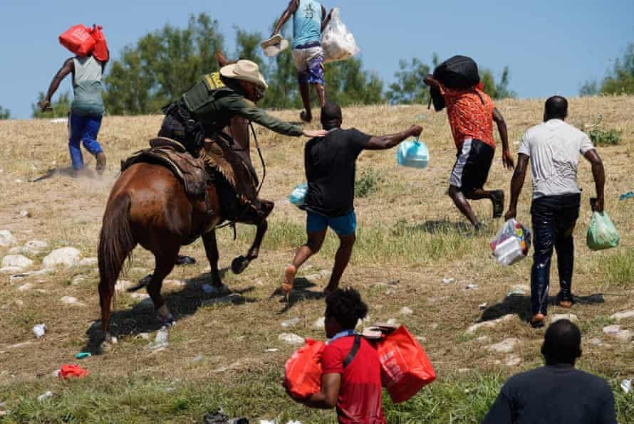 border patrol agent on horseback grabs migrant