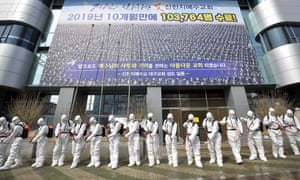 Soldiers spray disinfectant to prevent the spread of the coronavirus in front of a branch of the Shincheonji church of Jesus in Daegu, South Korea