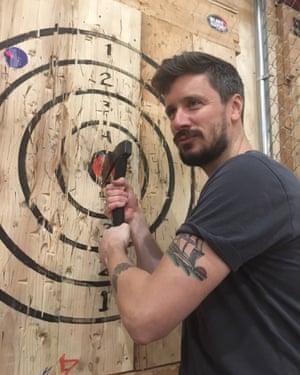 Reporter Adam Gabbatt tries his hand at axe-throwing at Bury the Hatchet in Brooklyn, New York.