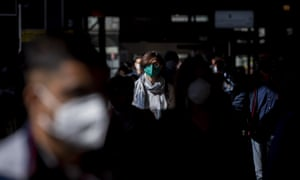 Rome commuters wearing face masks arrive at Termini station