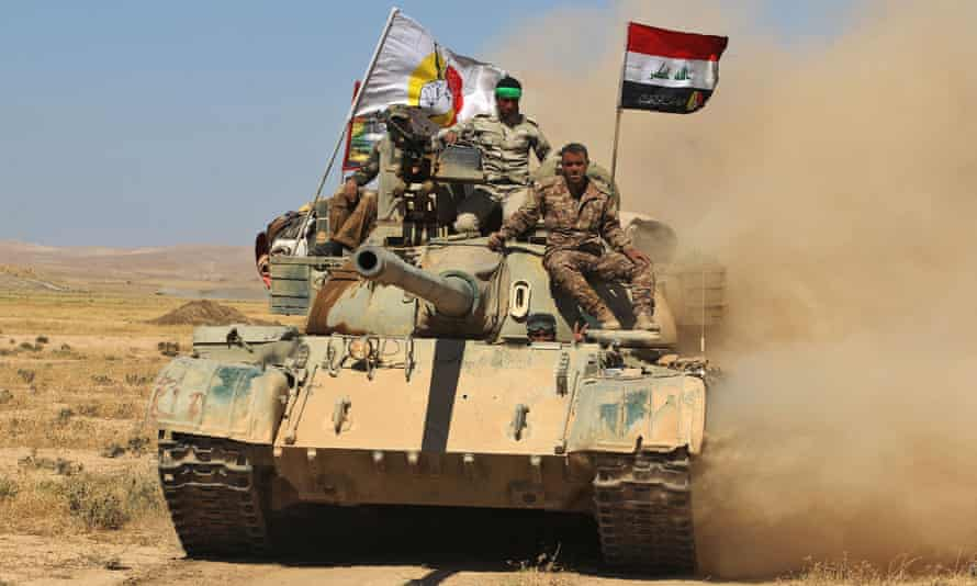 Fighters from the Hashed al-Shaabi (Popular Mobilisation Forces) advance towards Tal Afar.