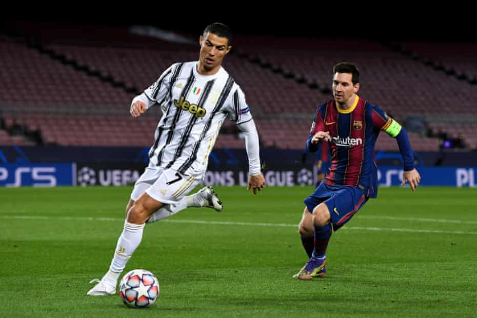 Messi chases down Ronaldo during Juventus's 3-0 win at Barcelona in December that clinched the Italian side a place in the Champions League knockout phase.