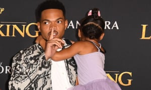 Chance the Rapper with his daughter at The Lion King premiere.