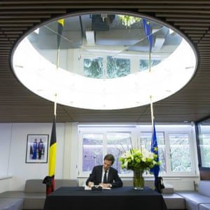 Dutch prime minister, Mark Rutte, signs a book of condolence during the commemoration for the vicitims of the Brussels attacks at the Belgian embassy, in The Hague, the Netherlands